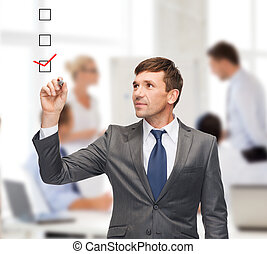 attractive businessman or teacher with marker