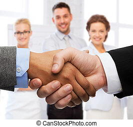 businessman and businesswoman shaking hands - business and...