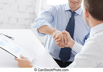 businessmen shaking hands in office - business and office...