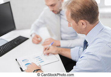 businessmen with notebook on meeting - business and office...