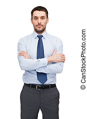 handsome buisnessman with crossed arms - business and office...
