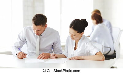 man and woman signing a contract - business and office - man...