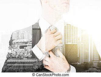 close up of man adjusting his tie