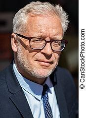close up of senior businessman in eyeglasses