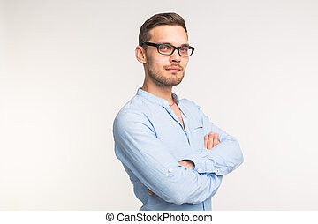 Business and people concept - Handsome man in black glasses over white background, arms crossed