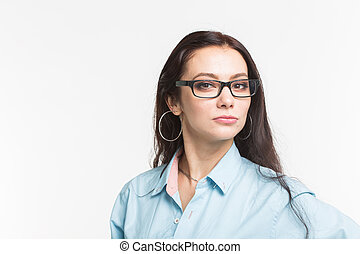 Business and people concept - young woman looking at you serious in glasses on white background with copy space