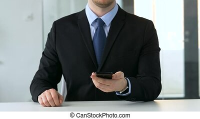businessman working with smartphone at office