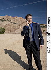 Business Anywhere - man on cell phone in desert