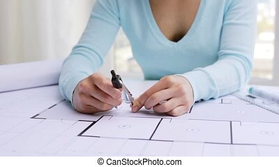 architect woman measuring blueprint with compass