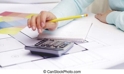 Architect with notebook blueprint and palettes stock videos woman with blueprint counting on calculator malvernweather
