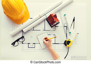 close up of architect hand with blueprint