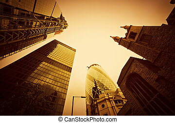 Business architecture, skyscrapers in London, the UK. Golden tint