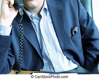 business as usual - businessman at the phone