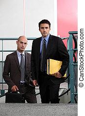Business associates arriving at work