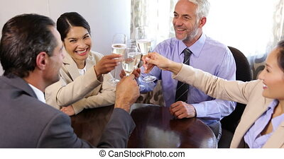 Business associates drinking champagne after work at the...