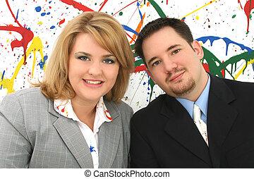 Business Associates - Professional woman and man team; paint...
