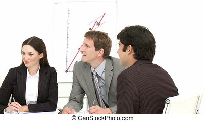 Business associates talking in a me
