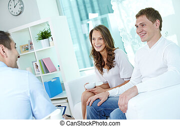 Business at home - Positive young couple at home having a...