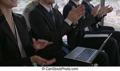 Business audience applaud at training