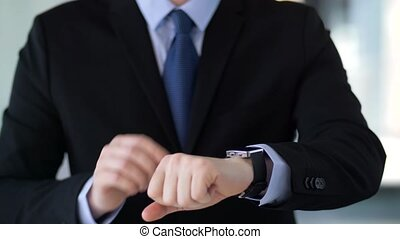 businessman working with smartwatch - business, augmented...