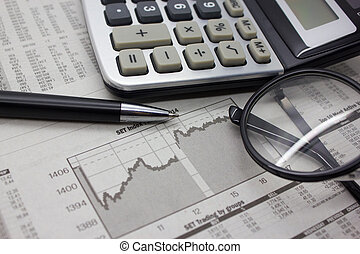 Business background with calculator and pen.