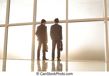 business background.business partners look through the...