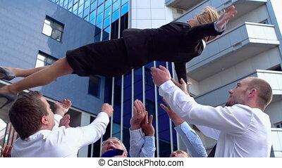 Business Balance - Business team celebrating success...