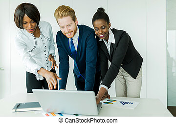 Business brainstorming by happy, nicely dressed multi-ethnic people