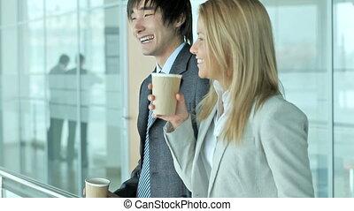 Business break - Cheerful colleagues having a coffee break
