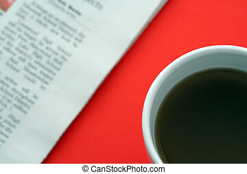 Business breakfast - A cup of coffee and a newspaper in a ...