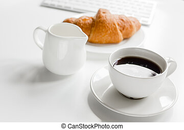Business breakfast in office with milk, coffee and croissant on white table background