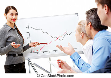 Business briefing - Image of smart business woman looking at...