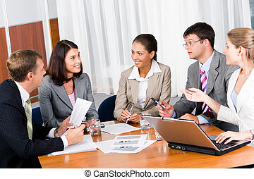 Business briefing - Portrait of five businesspeople sitting...