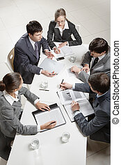 Business briefing - Team of five business people discussing ...