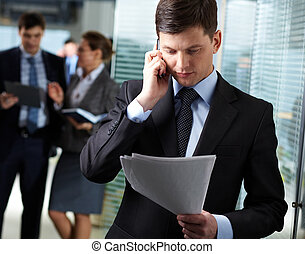 Business call - A handsome businessman calling by the phone ...