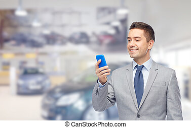happy businessman texting on smartphone - business, car...
