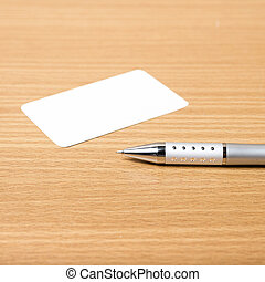 business card and pen