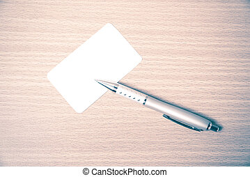 business card and pen vintage style