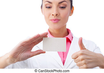 Business card - businesswoman holding blank sign, thumbs up. All isolated on white background.