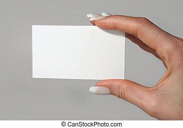Feminine hand holding a blank card