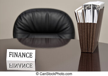 Business Card for Finance on Desk with Files
