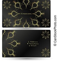 Business card gold ornament on a black background