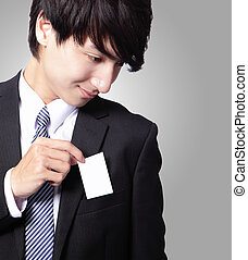 business card in business man suit pocket