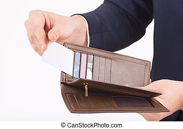 Male hand taking out business card from a wallet.