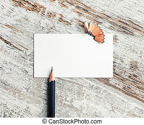 Business card, pencil