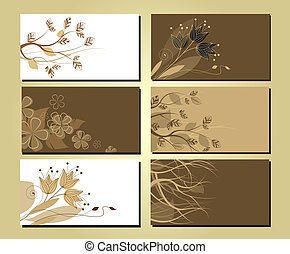 business cards with a floral motif and tree branches