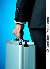 A businessman holding case