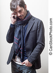 Business casual man with scarf calling