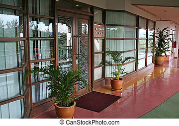 Business center entrance in a tropical resort hotel
