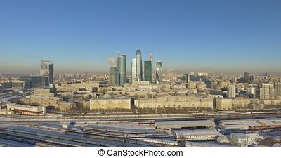 Business center Moscow City in the winter day aerial 4k flight around the skyscraper on drones
